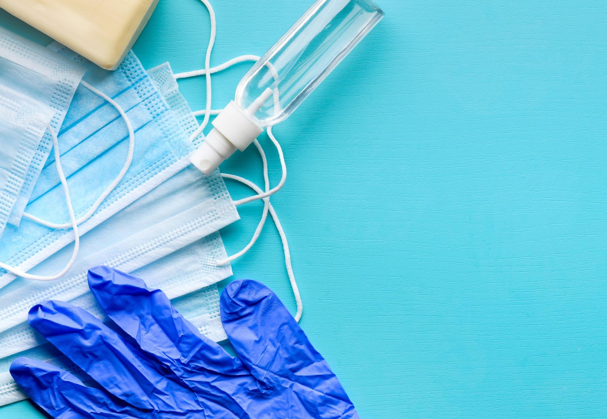 Assortment of PPE goods against a blue background