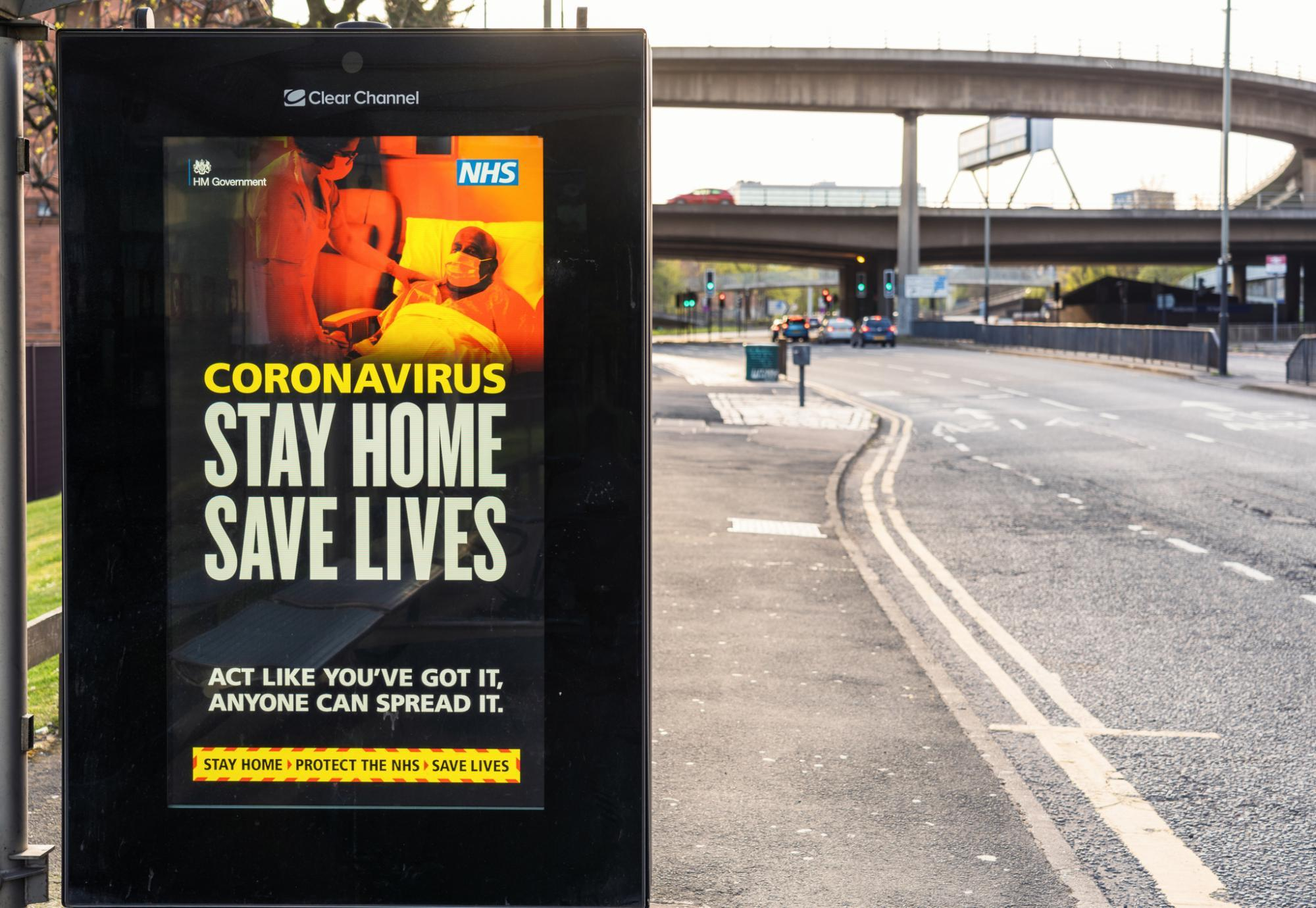 Stay Home Save Lives bus stop advertisement