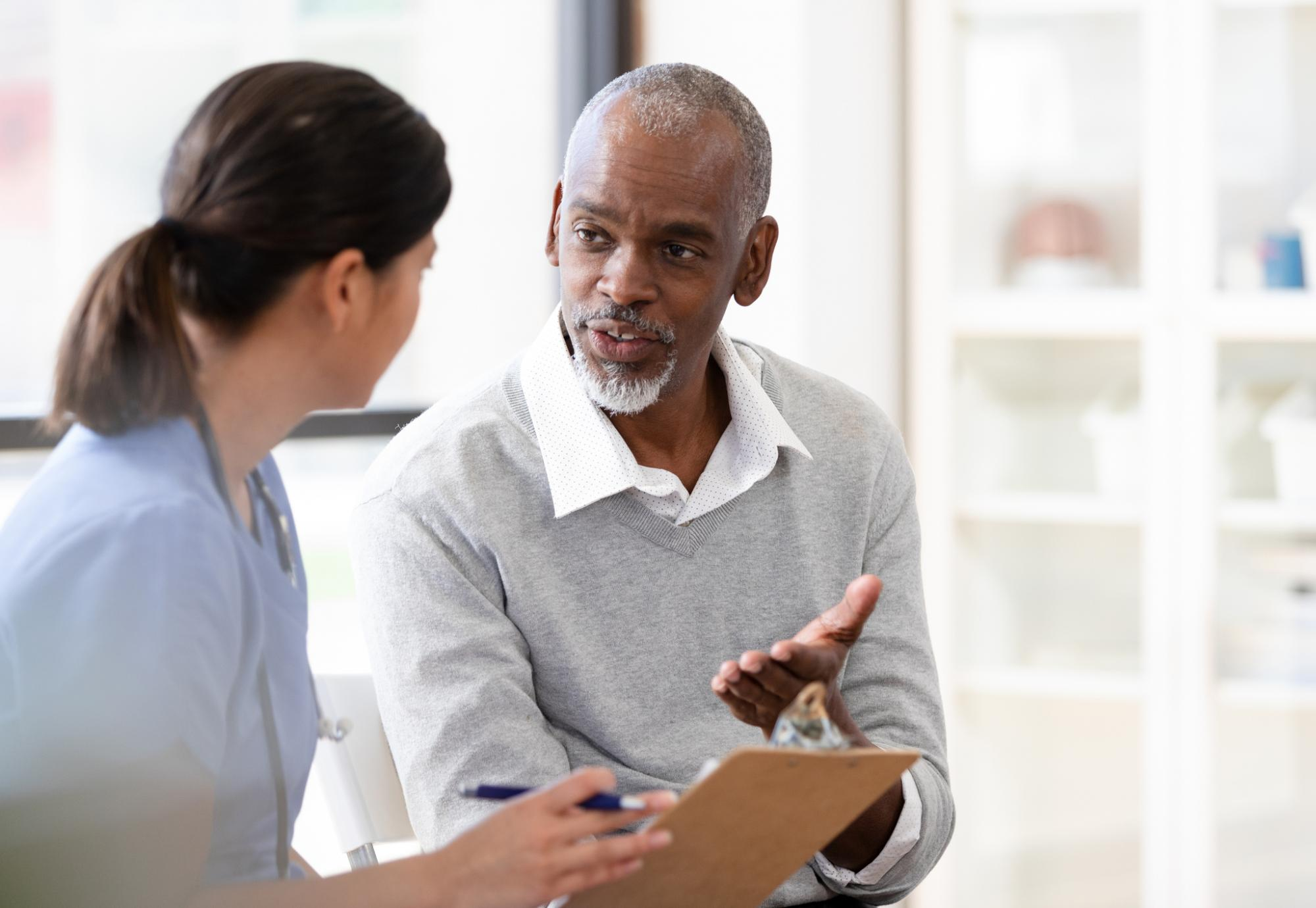 Patient in conversation with a health professional