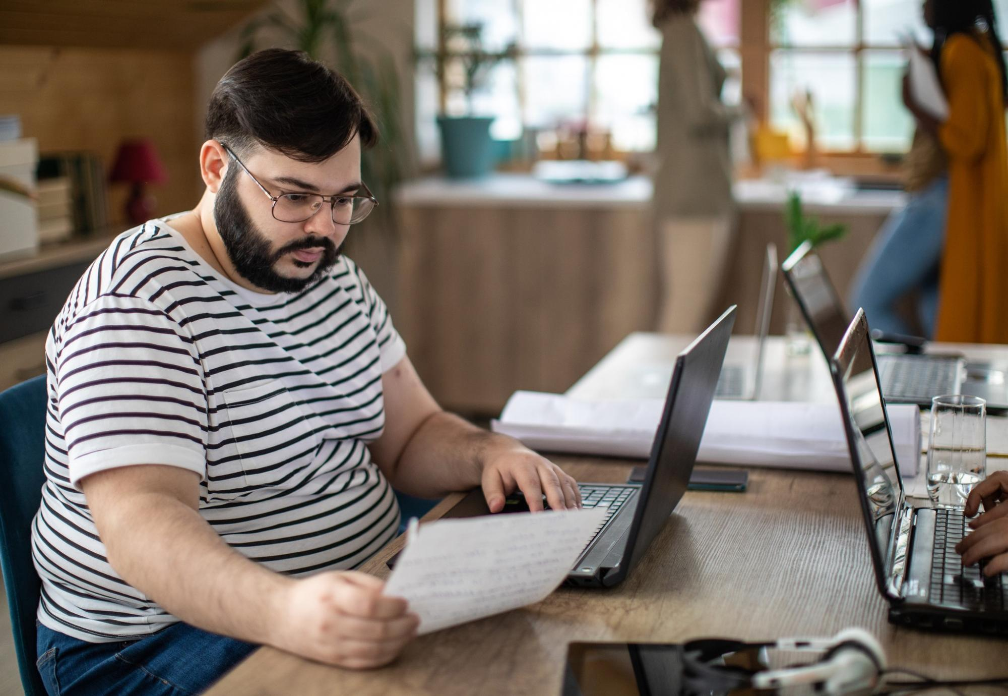 Overweight man at a laptop working