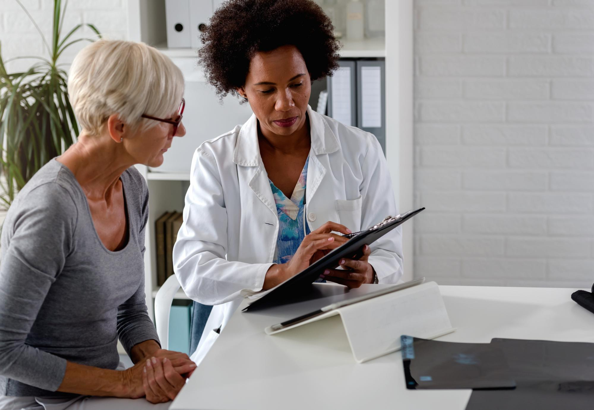 Female doctor discusses a diagnosis with a patient