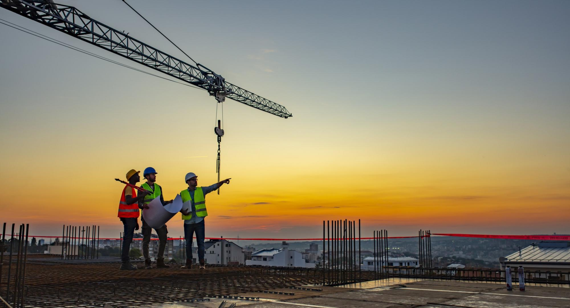 Construction workers stood atop a construction site