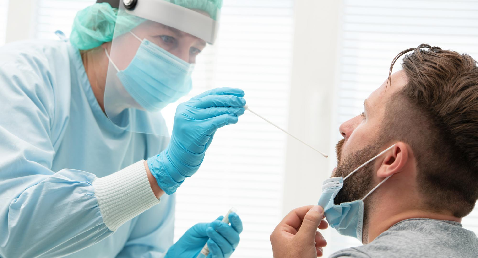 Health professional carrying out a nasal swab on a patient