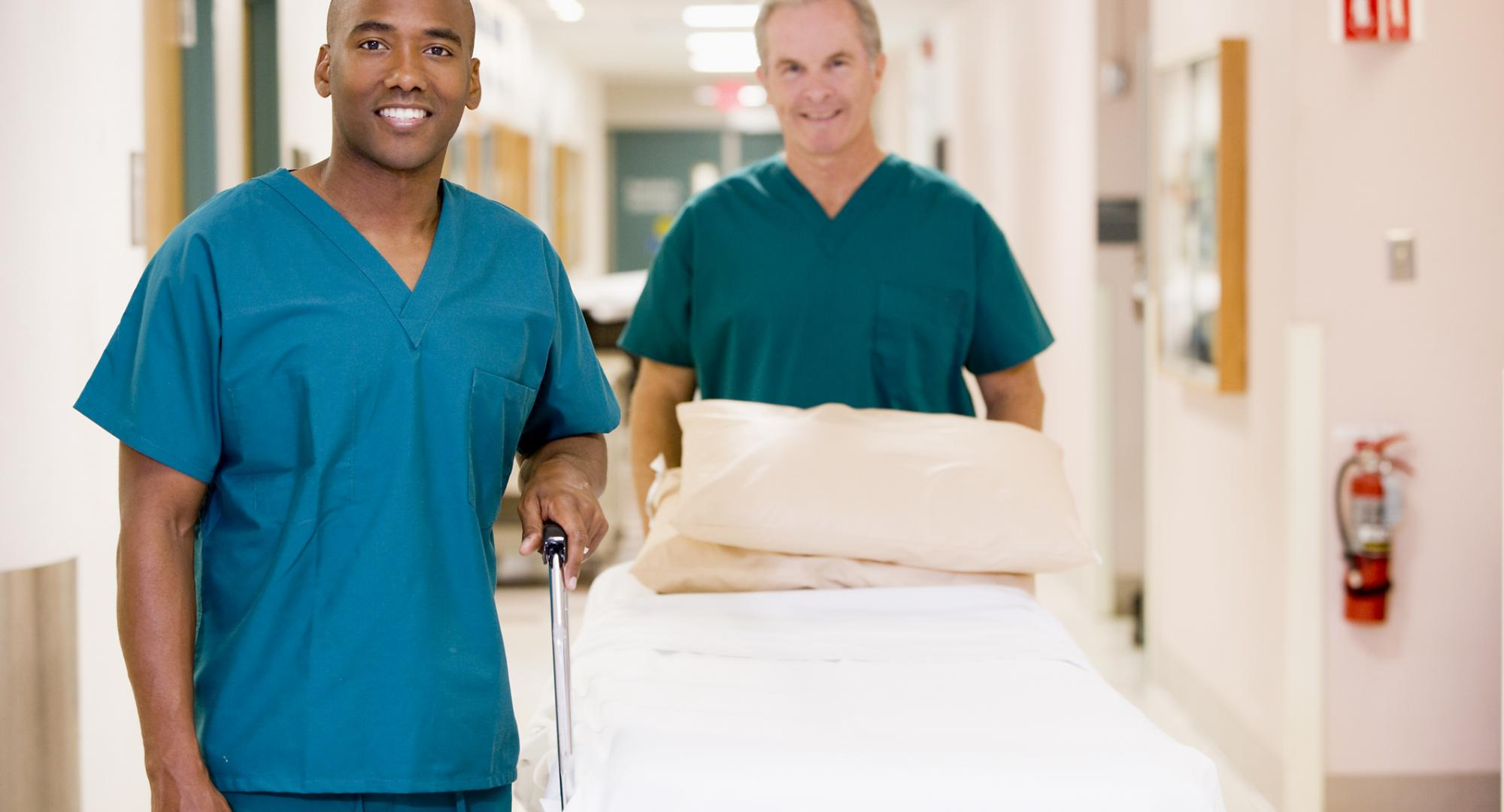 Two porters moving resources around the hospital