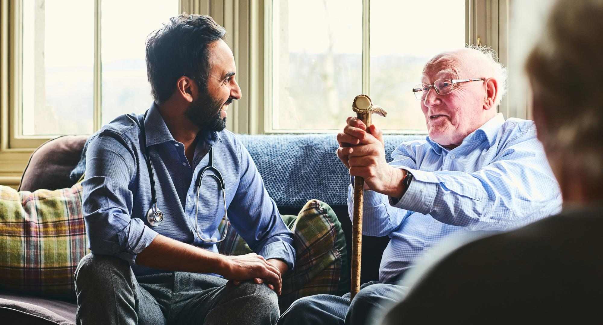 Doctor talking to an elderly care home resident