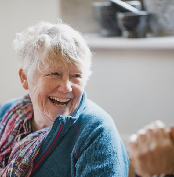 Senior woman smiling in conversation