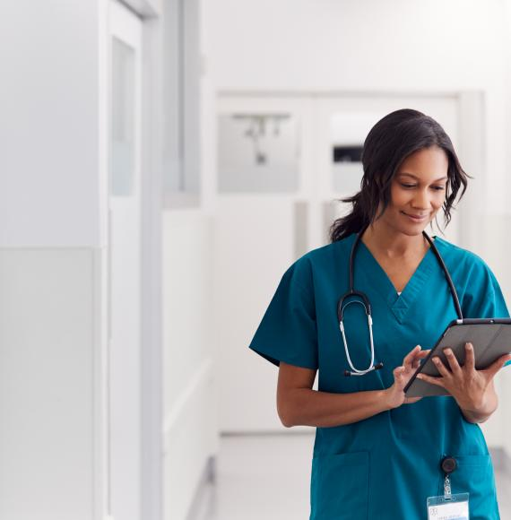 Female health professional using tablet computer