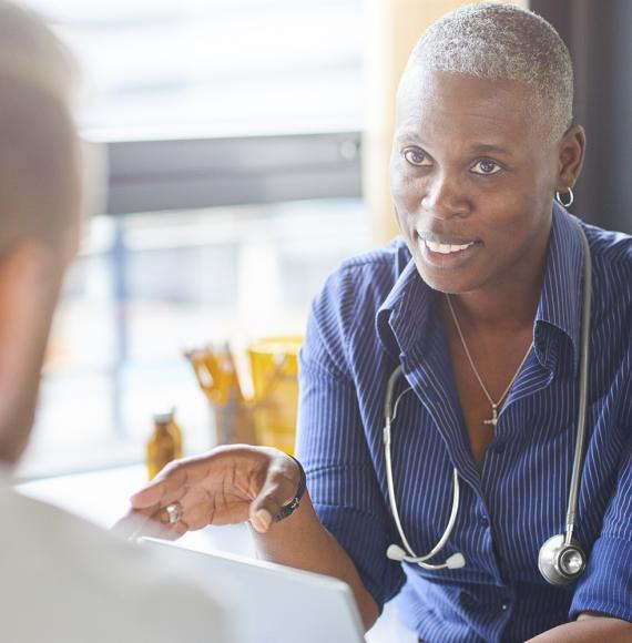Female GP discussing with patient