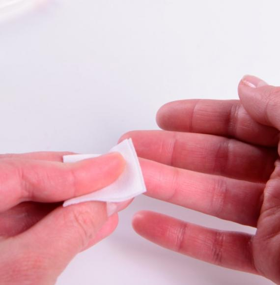 A person holding tissue on their finger
