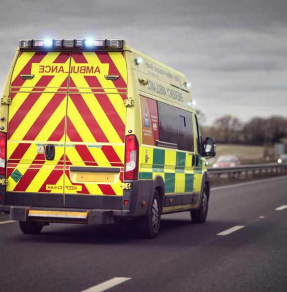 An ambulance on a road in the UK