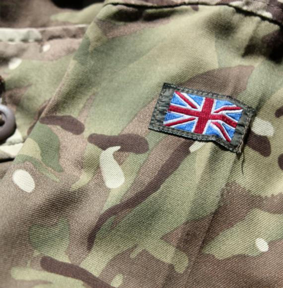 Close up photograph of British military uniform with stitched Union Jack flag