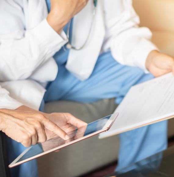 Two medical professionals looking at an iPad