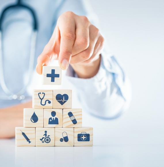 Illustration of the building blocks of health; health professional stacking objects