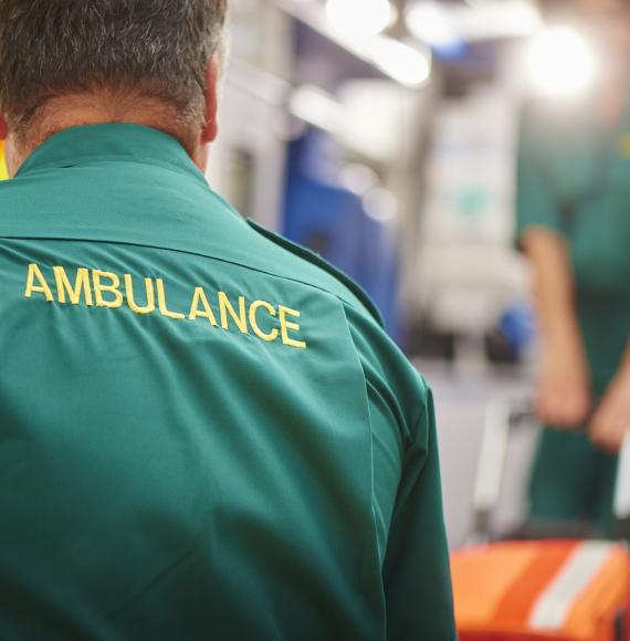 Back of a paramedic shirt emblazoned with the word ambulance