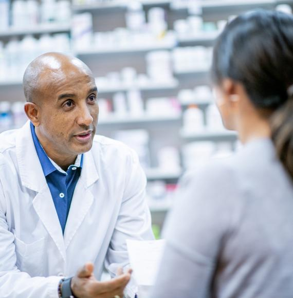 Pharmacist discussing with a customer