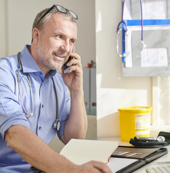 Consultant using the phone to speak with colleagues