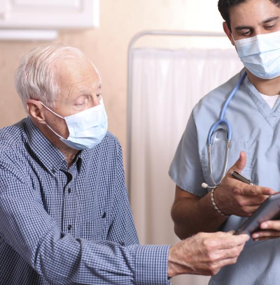 Elderly patient talking with a hospital clinician