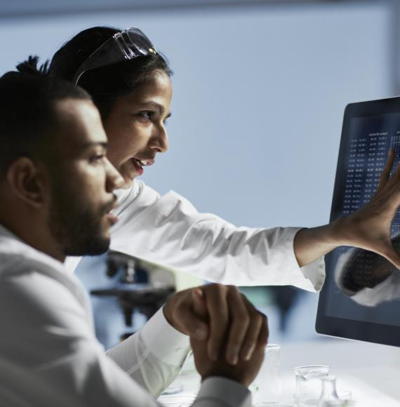 Medical researchers reviewing data on a screen
