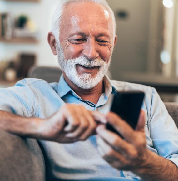 Older man using a phone to read a text message