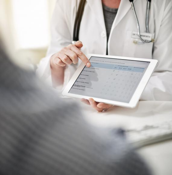 Health professional accessing a form on a tablet PC