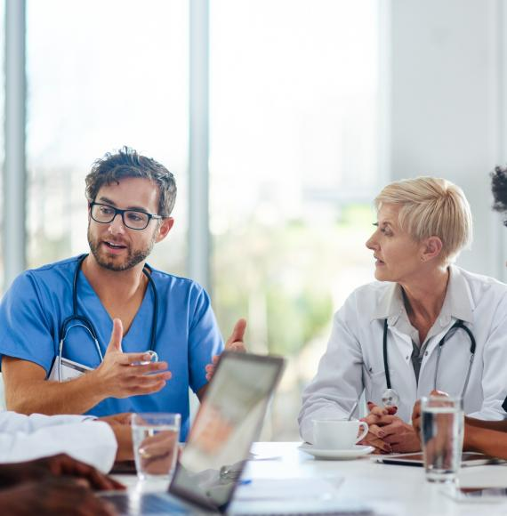 Doctors sat in a meeting discussing plans