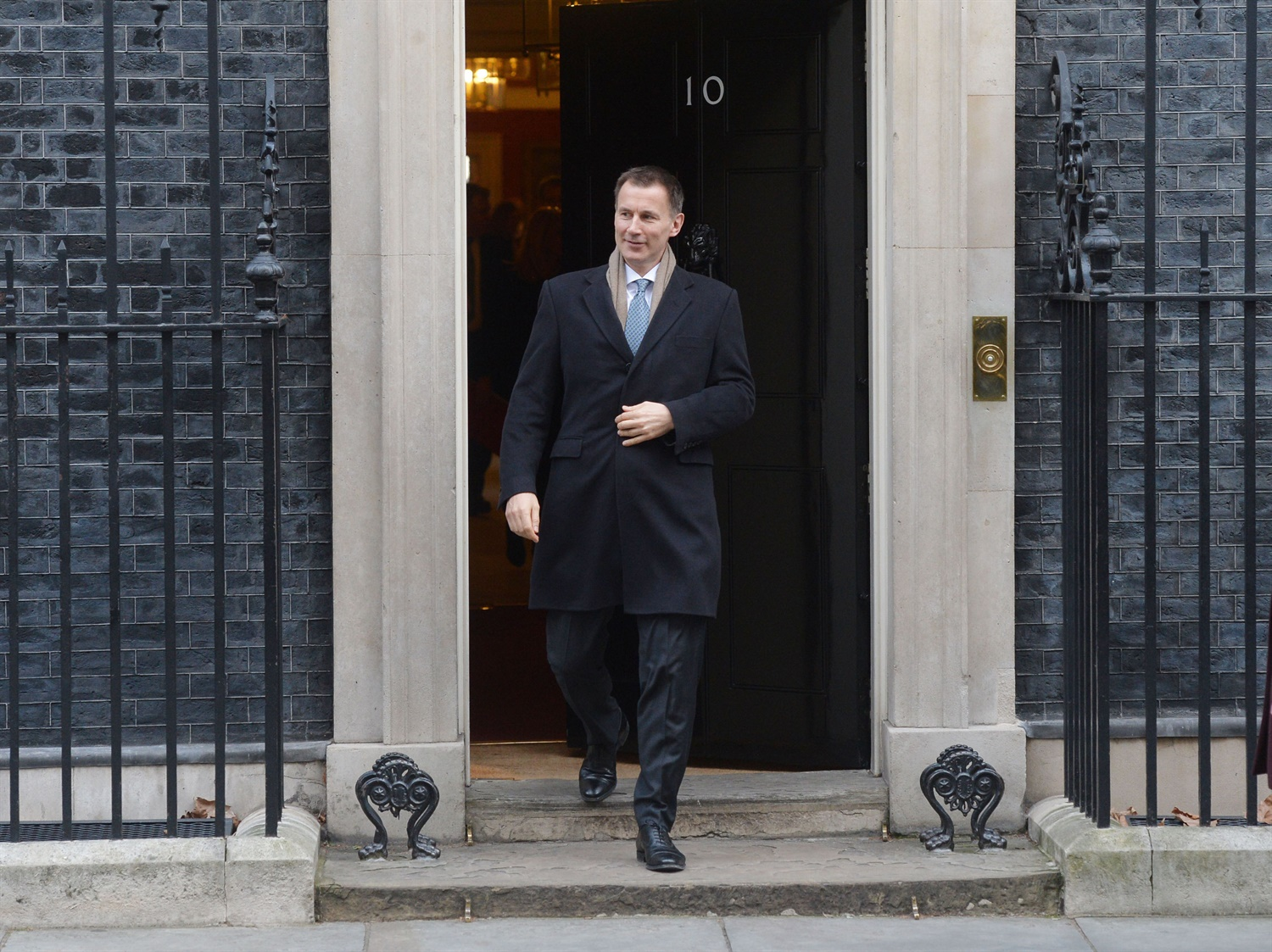 Hunt under investigation over failure to declare luxury flats